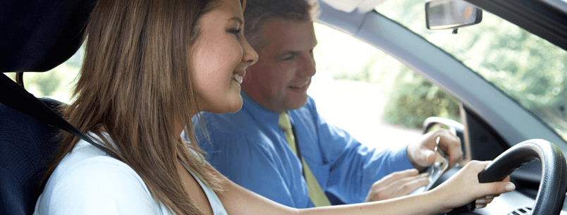 Refresher Driving Lessons in Dublin: Picture of a woman driving car with her instructor: Pre Test Driving Lessons in Dublin